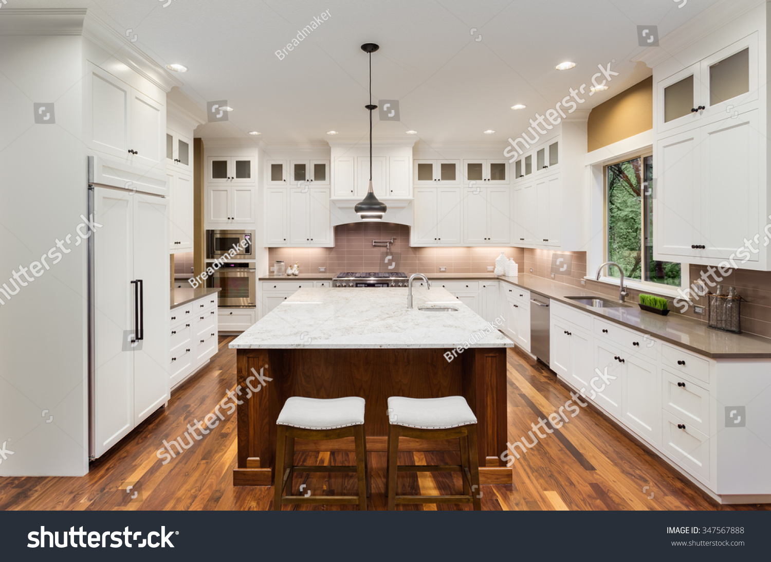 Large White Kitchen Sink : Large Kitchen Interior with Island, Sink, White Cabinets, Pendant ...