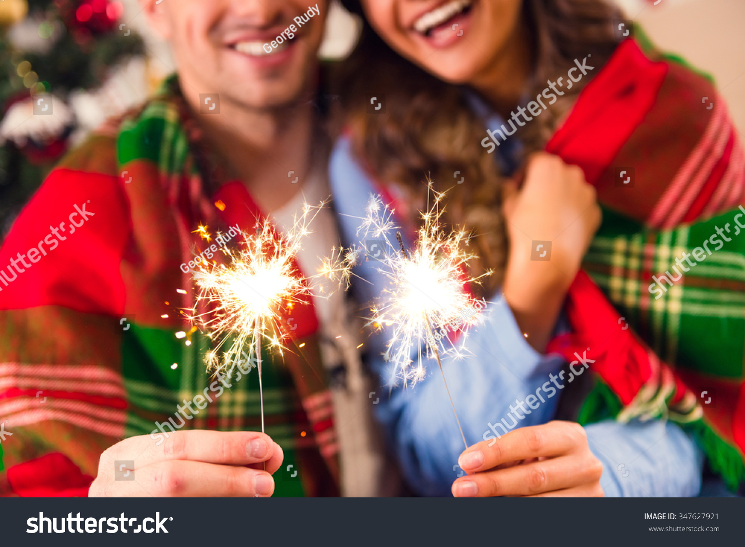 Young happy couple during the celebration of Christmas at home #347627921