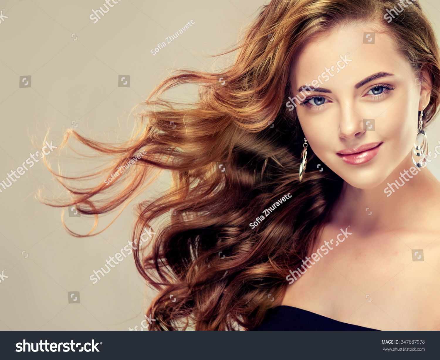 Beautiful Girl With Long Wavy Hair Brunette With Curly