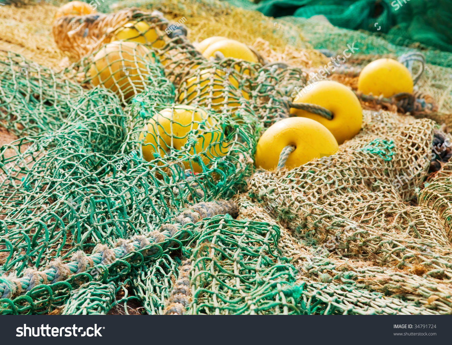 Fishing nets and floats stock photo 34791724 shutterstock for Fishing net floats