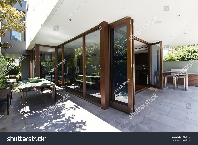 Bi fold doors opening to rear courtyard of contemporary Australian home & Bi Fold Doors Opening Rear Courtyard Stock Photo 348109004 ... pezcame.com