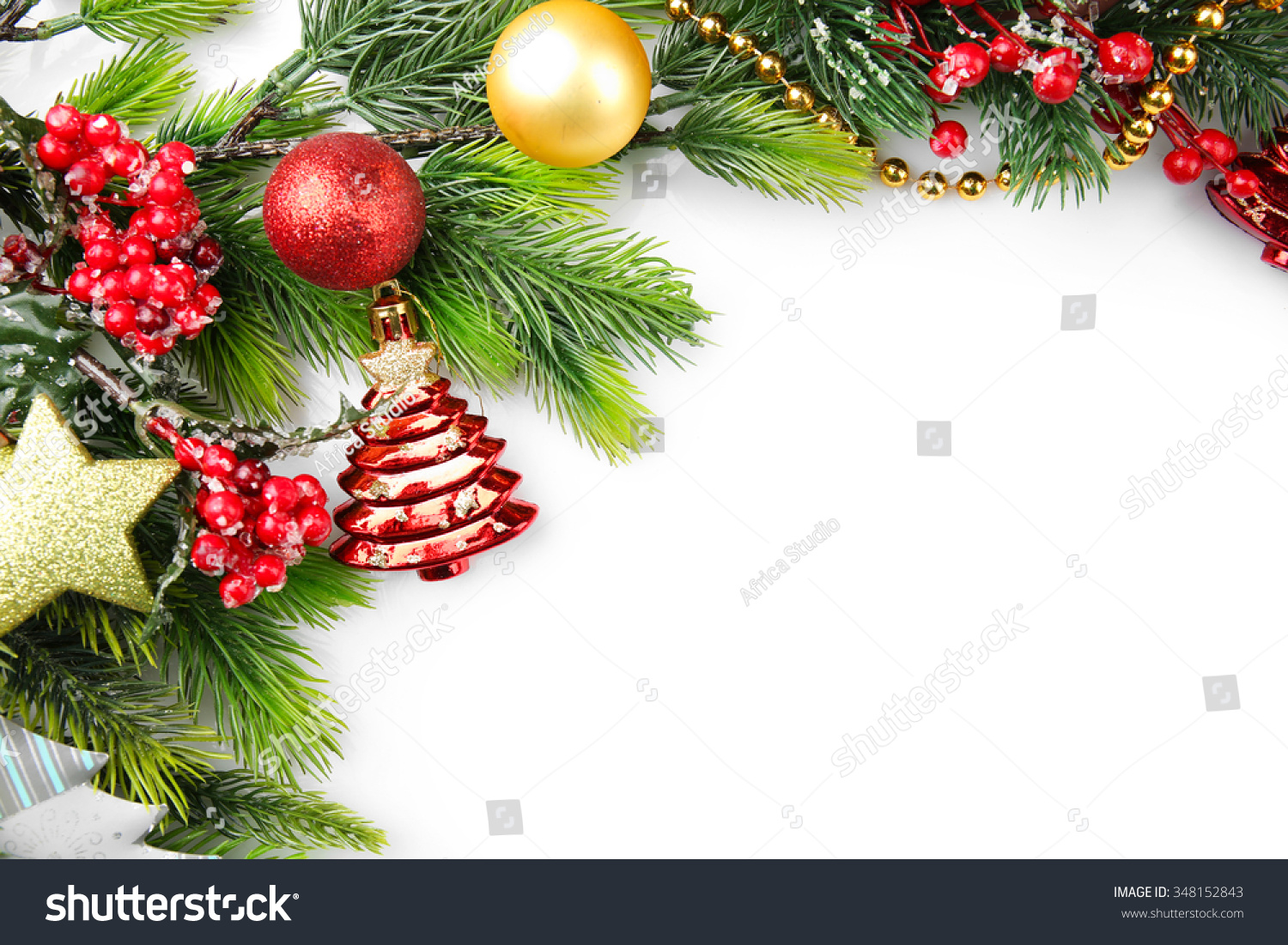 Christmas Tree Branch With Red Berries And Decorations On