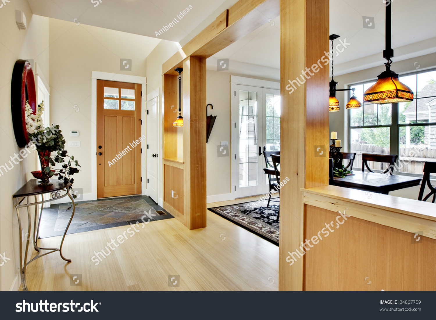 Wide view home entrance hallway dining stock photo for Dining room entrance