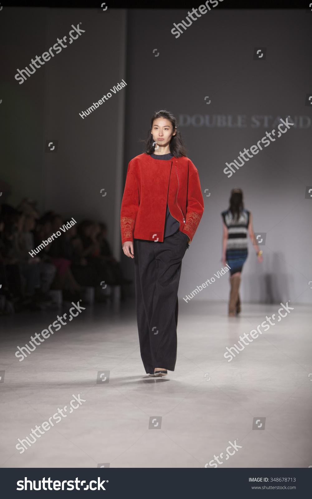 Fashion Expo Standsaur : Model walks runway double standard clothing stock photo