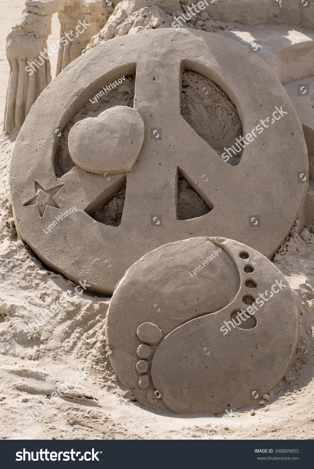 Sand sculpture peace sign heart star stock photo 348809855 sand sculpture of a peace sign heart star and yin yang symbol on fort biocorpaavc