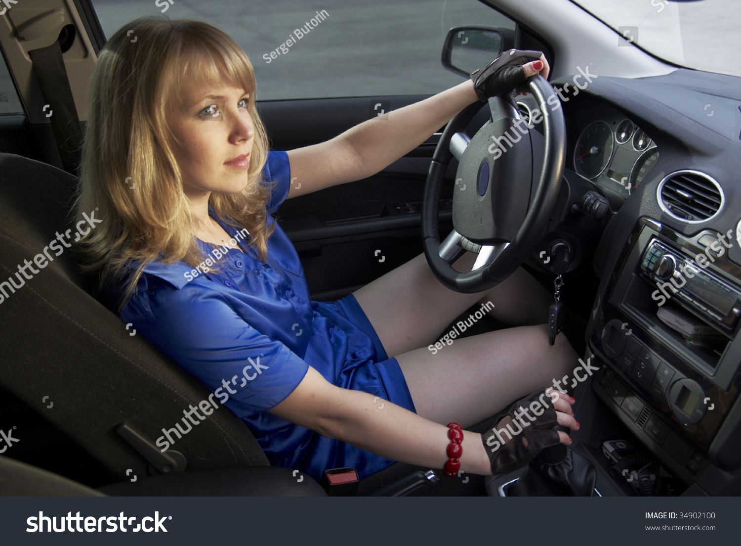 Driving gloves girl - Driving Girl With Hand In Glove On Speed Lever