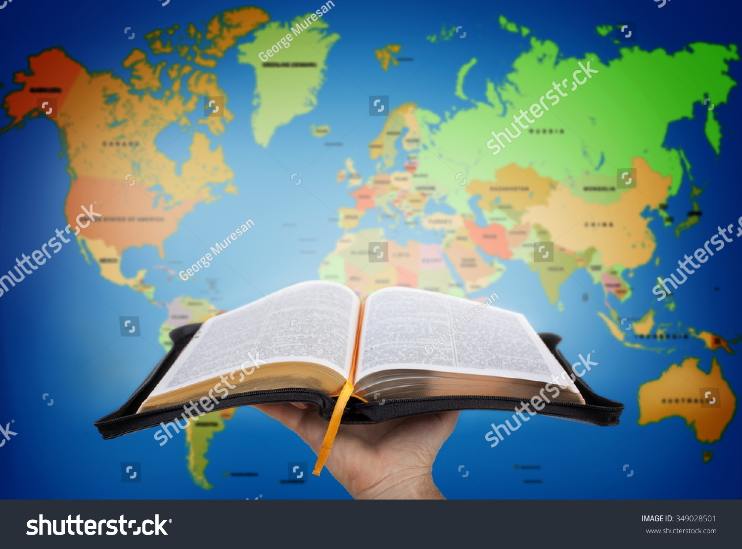 Hand Showing Holy Bible Against World Stock Photo Edit Now