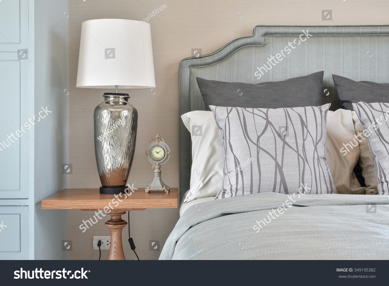 Silver base table lamp clock classic stock photo 349195382 silver base table lamp with clock and classic gorgeous bedding style geotapseo Choice Image