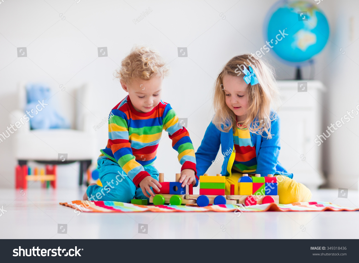 Day Care Toys : Children playing wooden train toddler kid stock photo