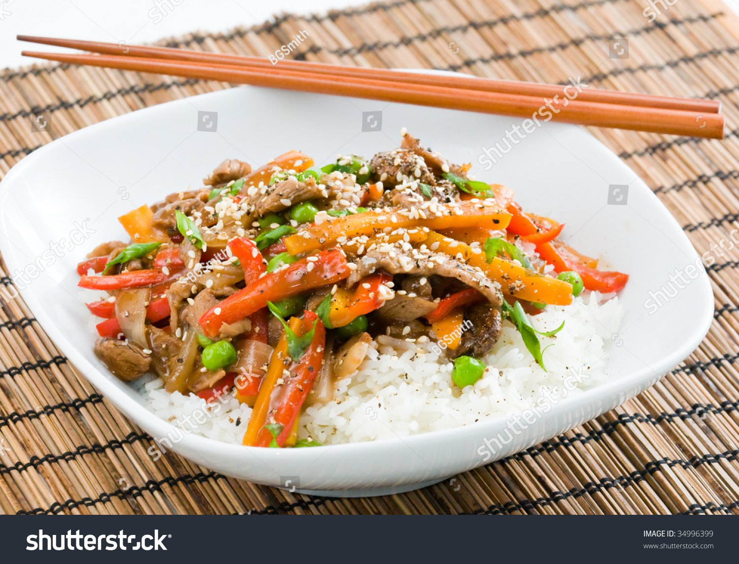 ... -fry on rice with peppers carrots onions and peas in black bean sauce