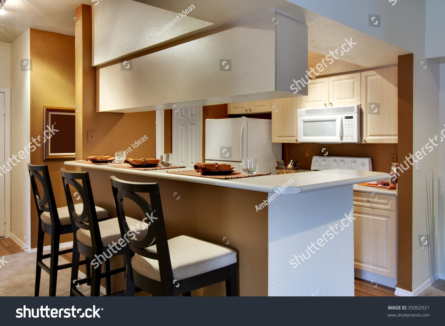 Kitchen Area Of Apartment With High Bar Style Countertop