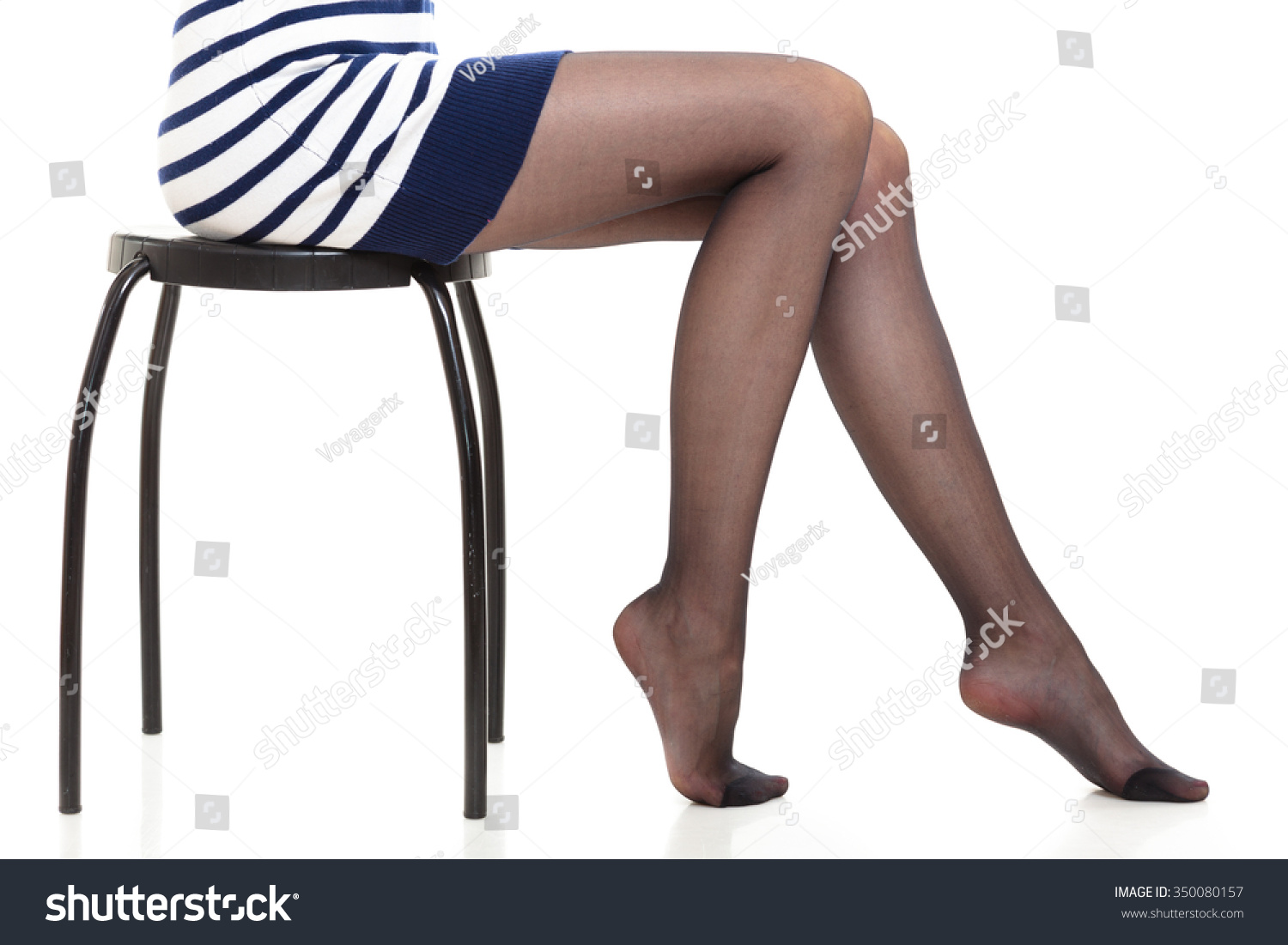 2c0042002d750 Beauty woman legs in black tights. Part body of slim attractive girl  wearing striped dress