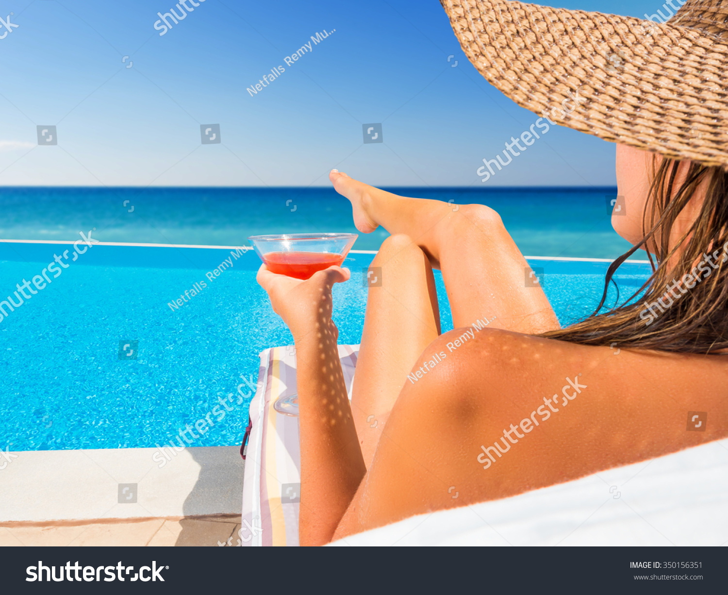 beautiful woman hat relaxing infinity pool stock photo 350156351