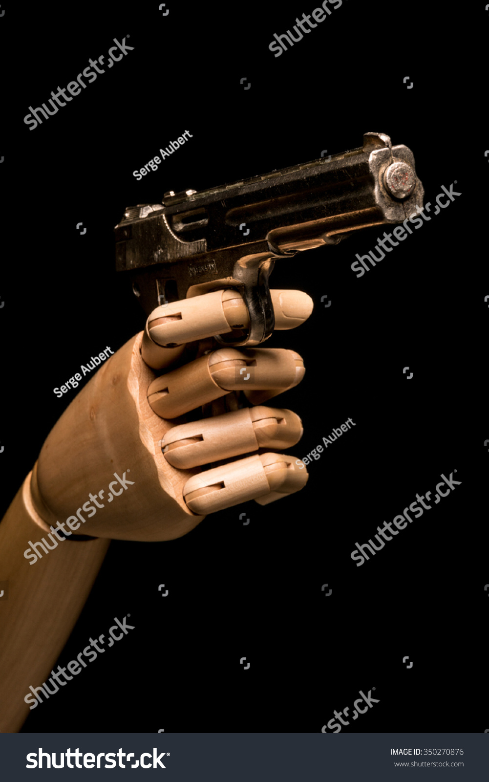 Wooden Hand Brandishes Dummy Gun On Stock Photo (Edit Now