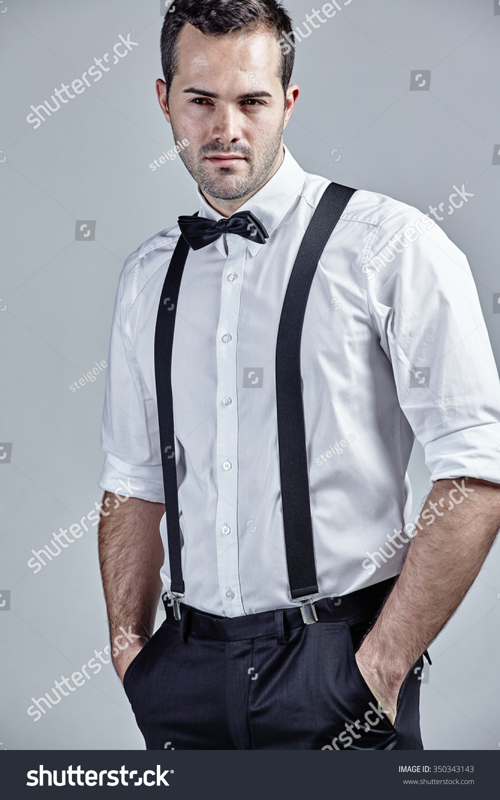 f939b02db5bc Man with suspenders and bow tie… Stock Photo 350343143 - Avopix.com