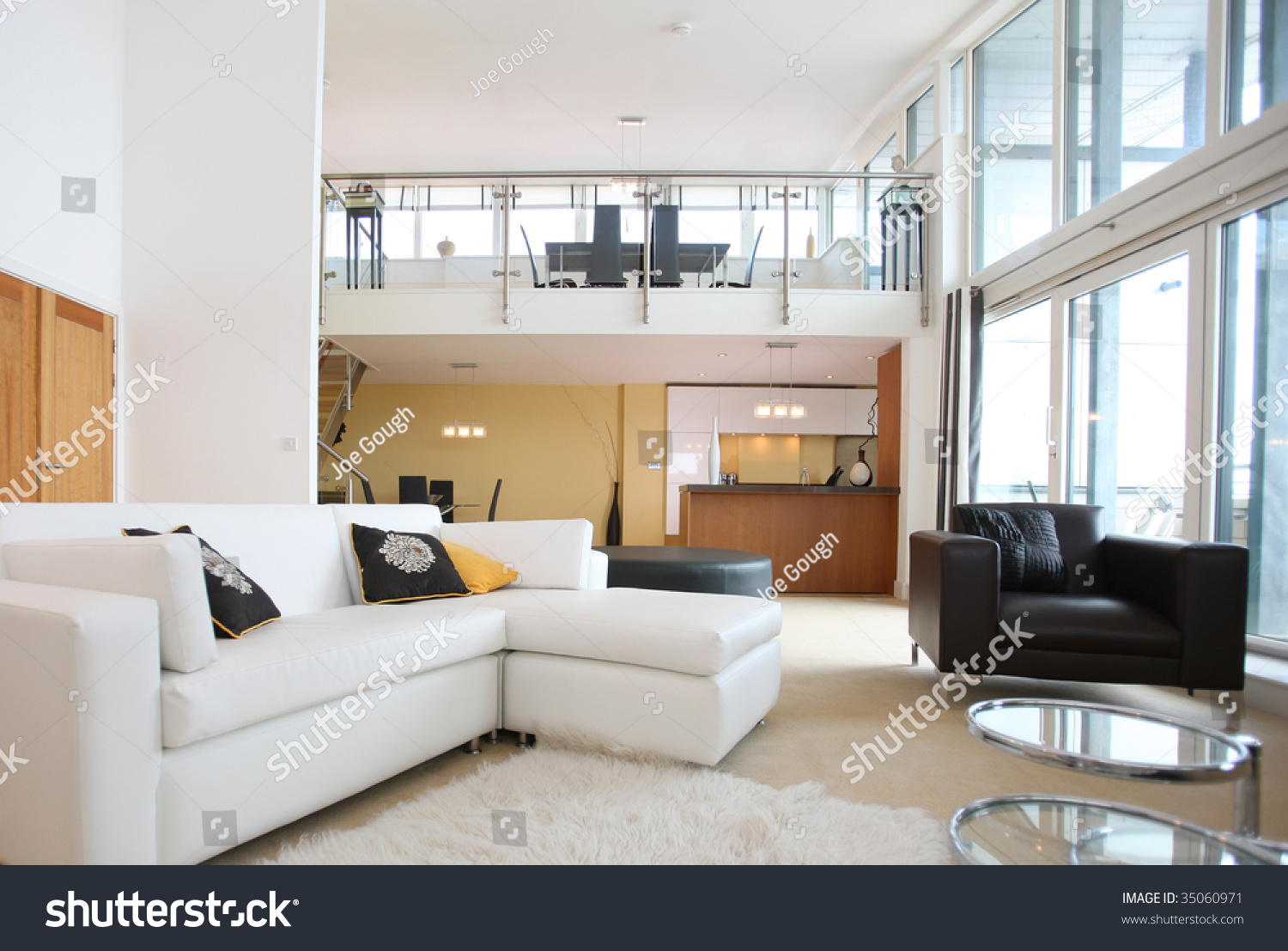Modern openplan apartment living room foreground stock for Contemporary open plan kitchen living room