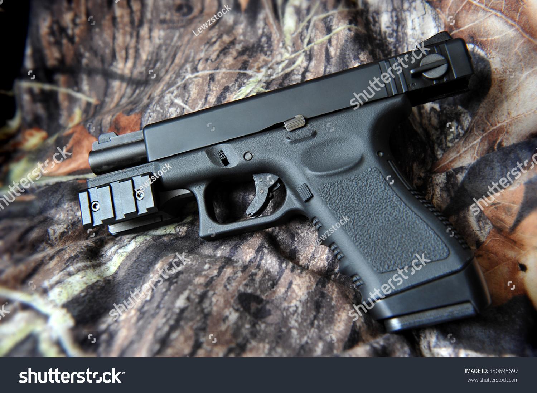 Glock 23 milspec  40 super short gun Stock Photo 350695697 - Avopix com