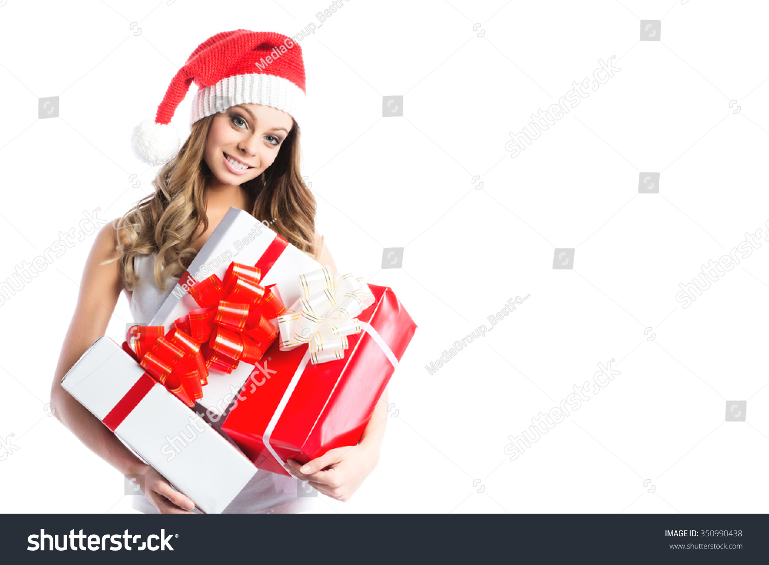 Woman holding Christmas gifts. Beautiful young female model isolated ...