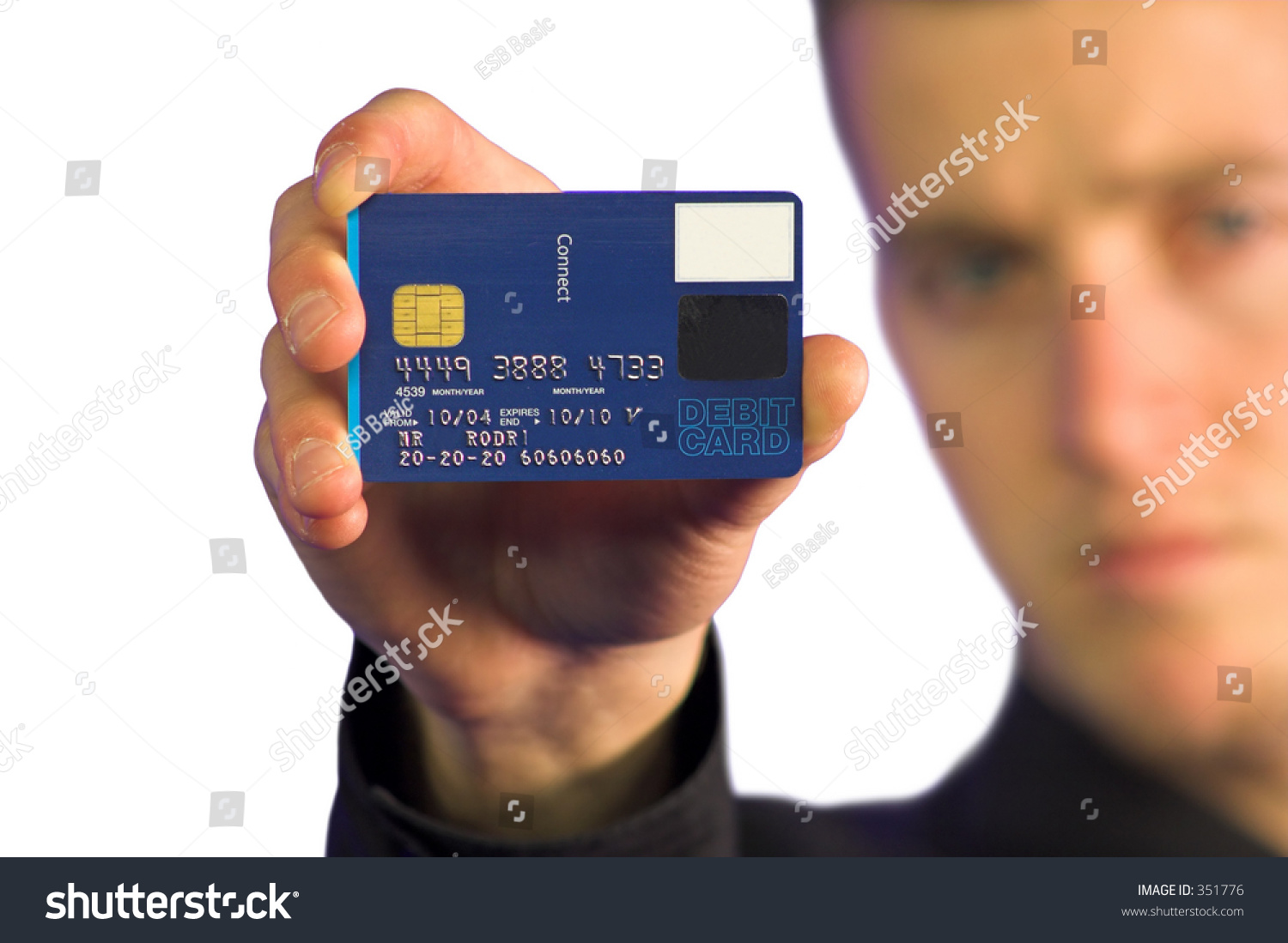 business man holding up a credit card