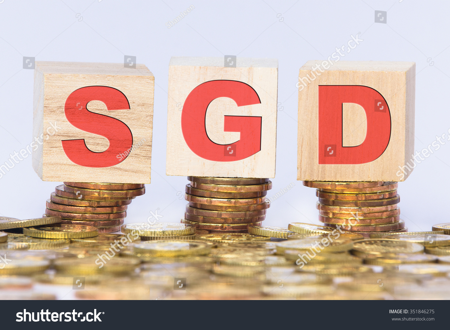 Wooden block written sgd abbreviations singapore stock photo wooden block with written sgd abbreviations of singapore dollar on stacked gold coins biocorpaavc