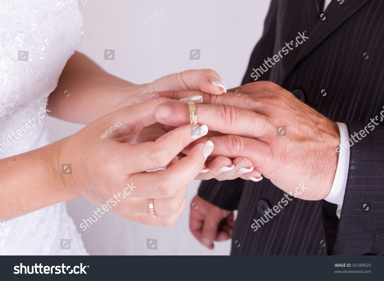 Bride Putting Wedding Ring On Grooms Stock Photo (100% Legal ...