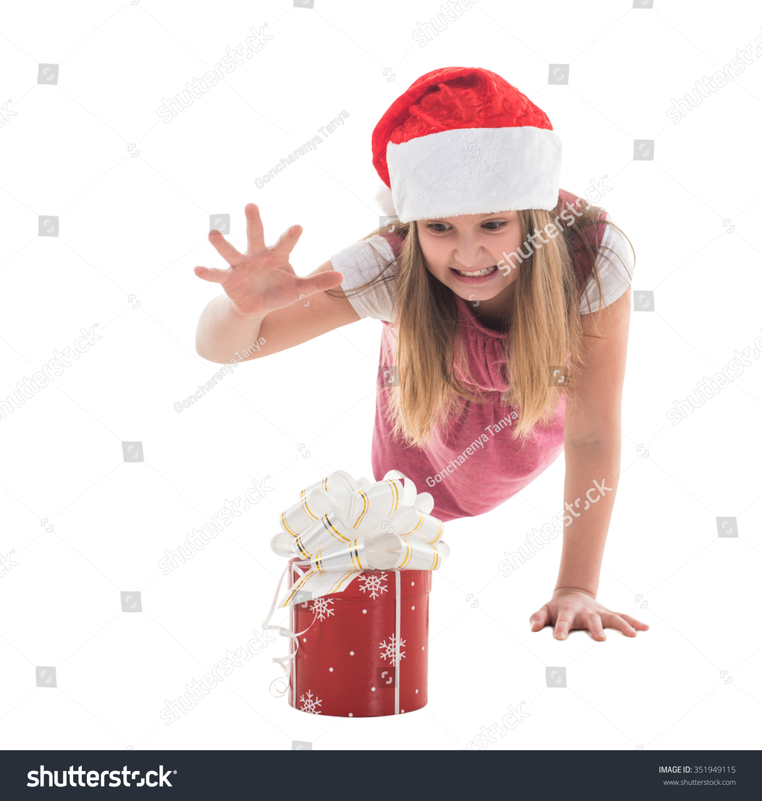 Little girl in the hat of Santa Claus isolated