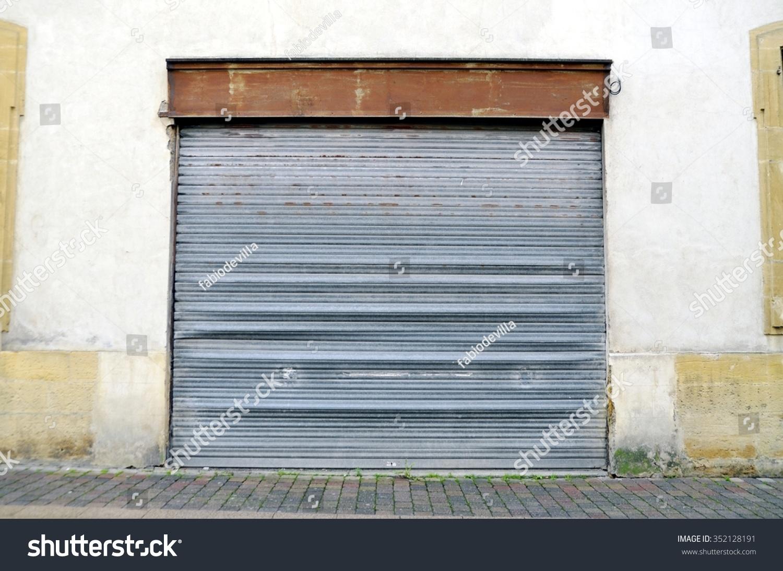 Old Grey Vintage Garage Door At A House Corrugated Metal Sheet Slide