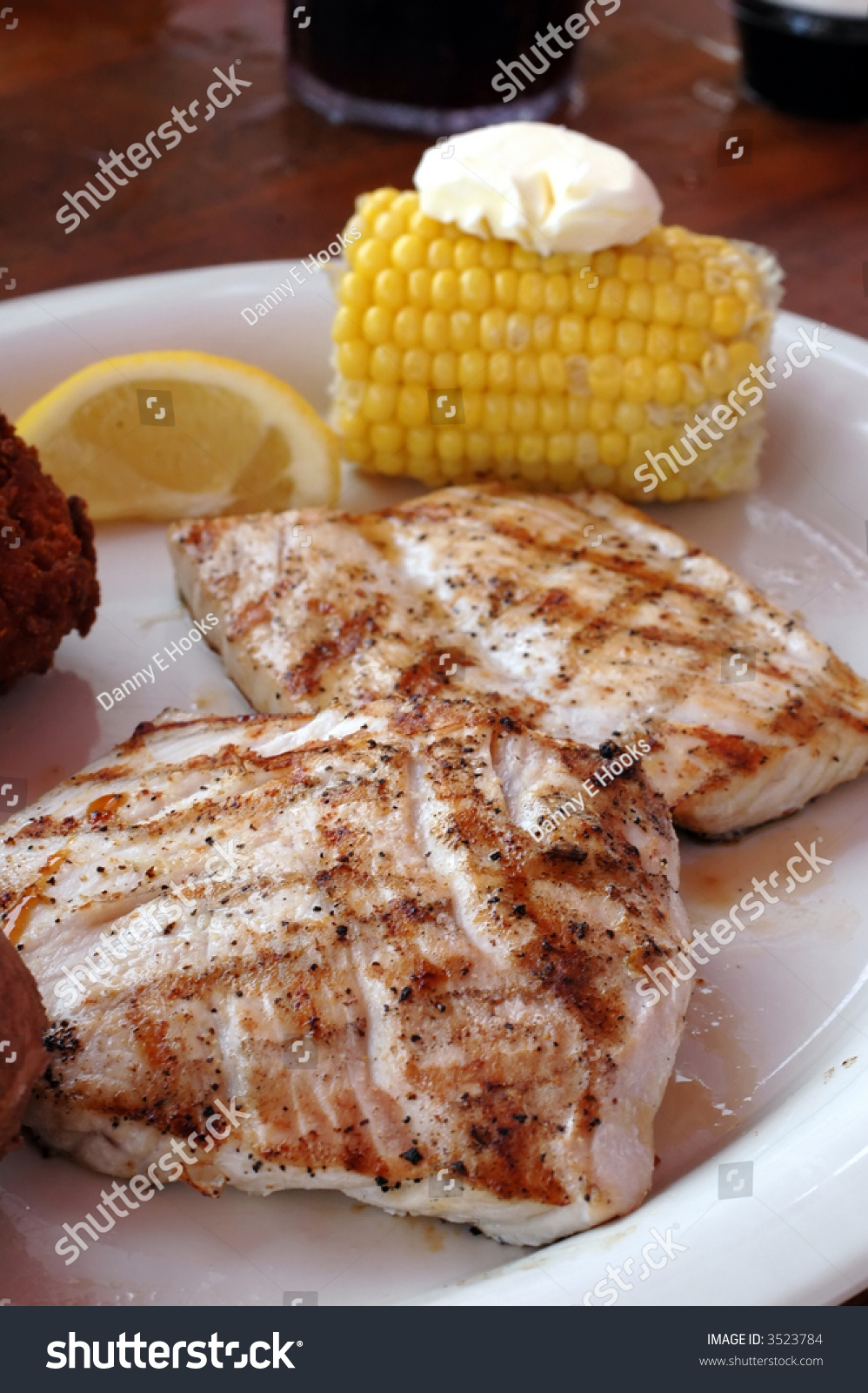 Grilled amberjack with corn on the cob hush puppies and for Amberjack fish recipes