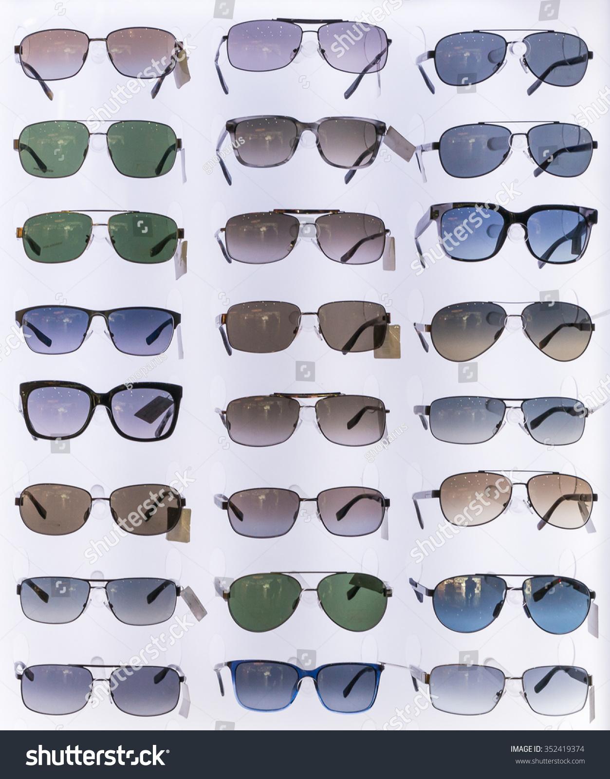 Eyeglasses display - Sunglasses Shades Eyeglasses Display Backlight Stand At Unidentified Fashion Shop Shelf In Airport Duty