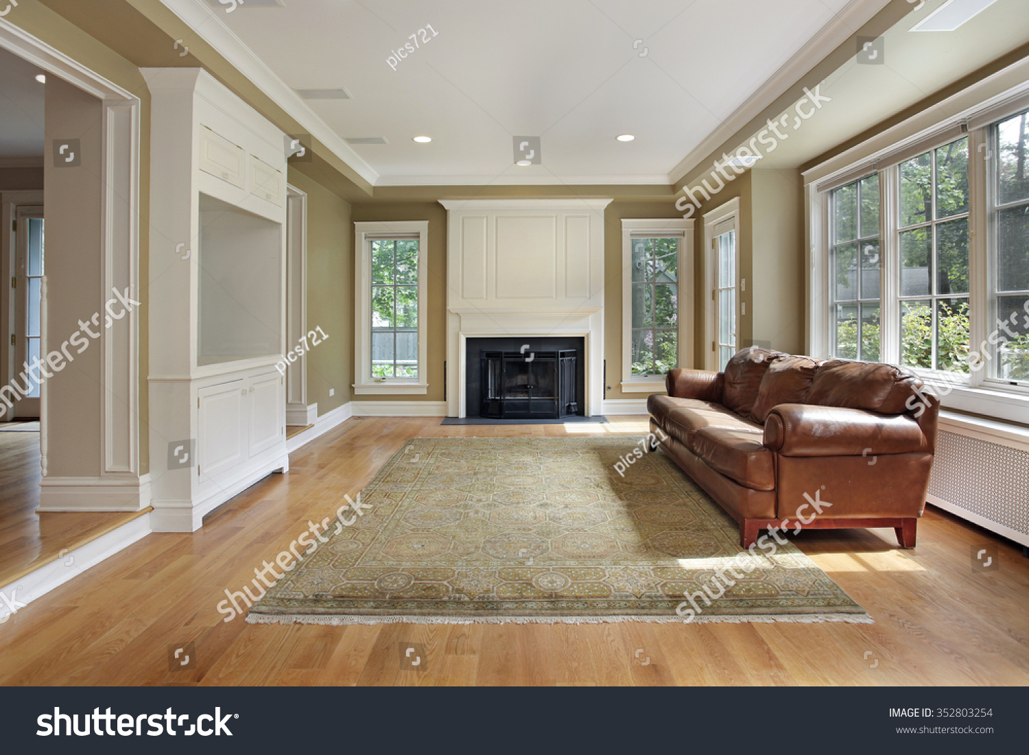 Family Room In Luxury Home With Fireplace Stock Photo