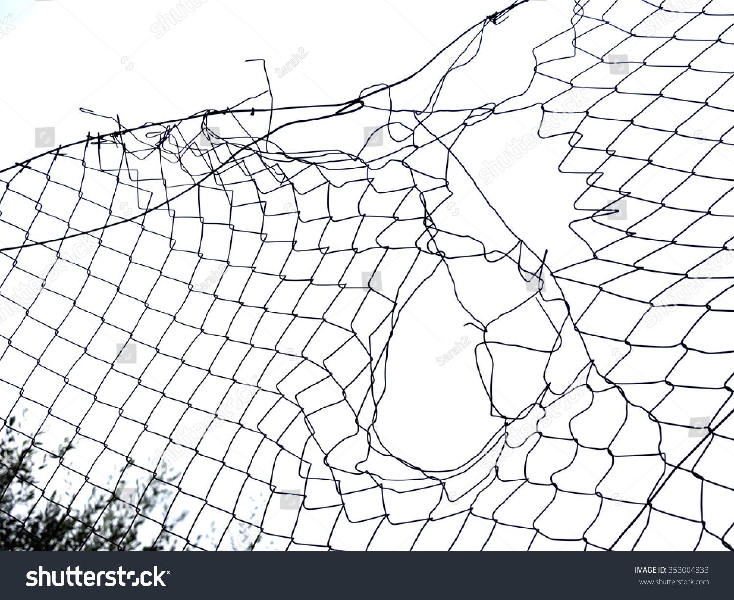 Royalty-free Hole, gap in the wire mesh fence, white… #353004833 ...