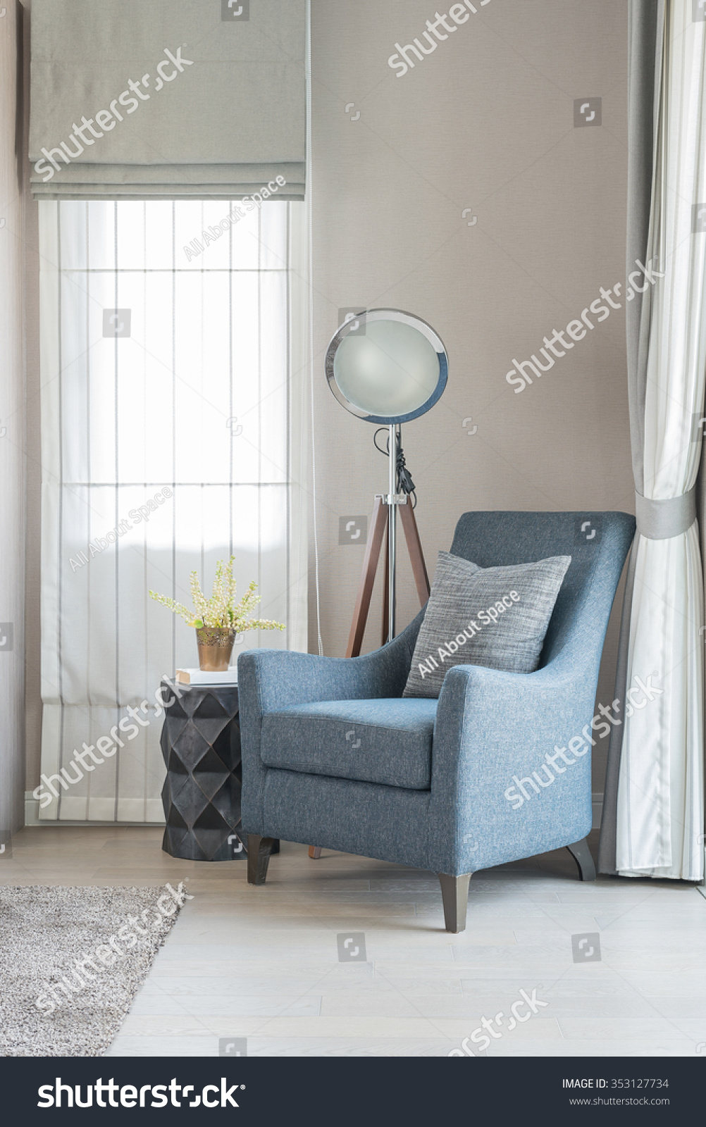 classic style sofa with pillows and modern lamp in living room