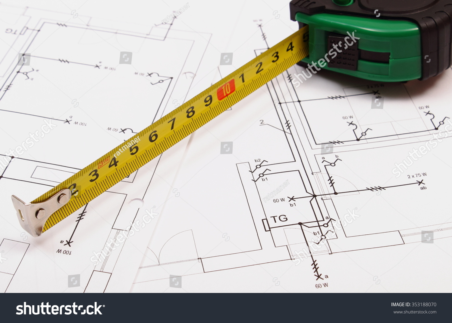 Tape measure on electrical construction drawing of house, work tool ...
