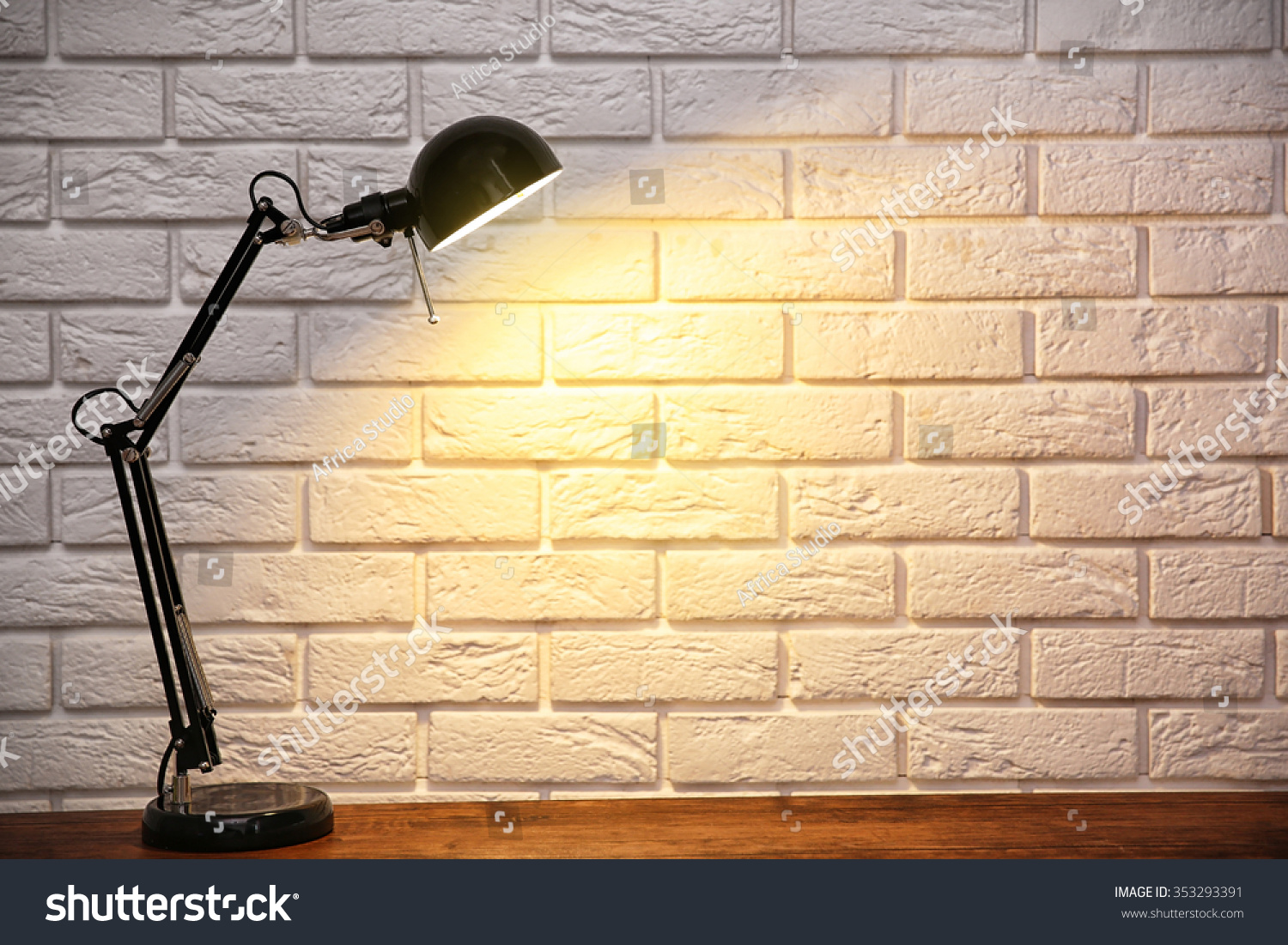 Modern lamp on table on brick stock photo 353293391 shutterstock modern lamp on table on brick wall background geotapseo Image collections