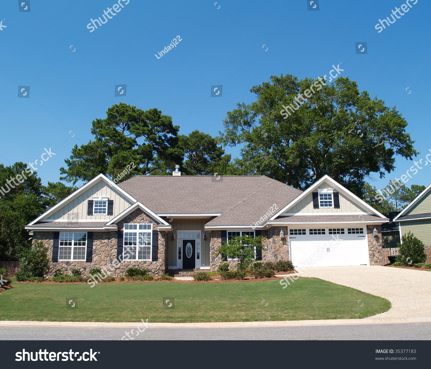 Stone Residence 1: One Story Residential Home Stone Facade Stock Photo