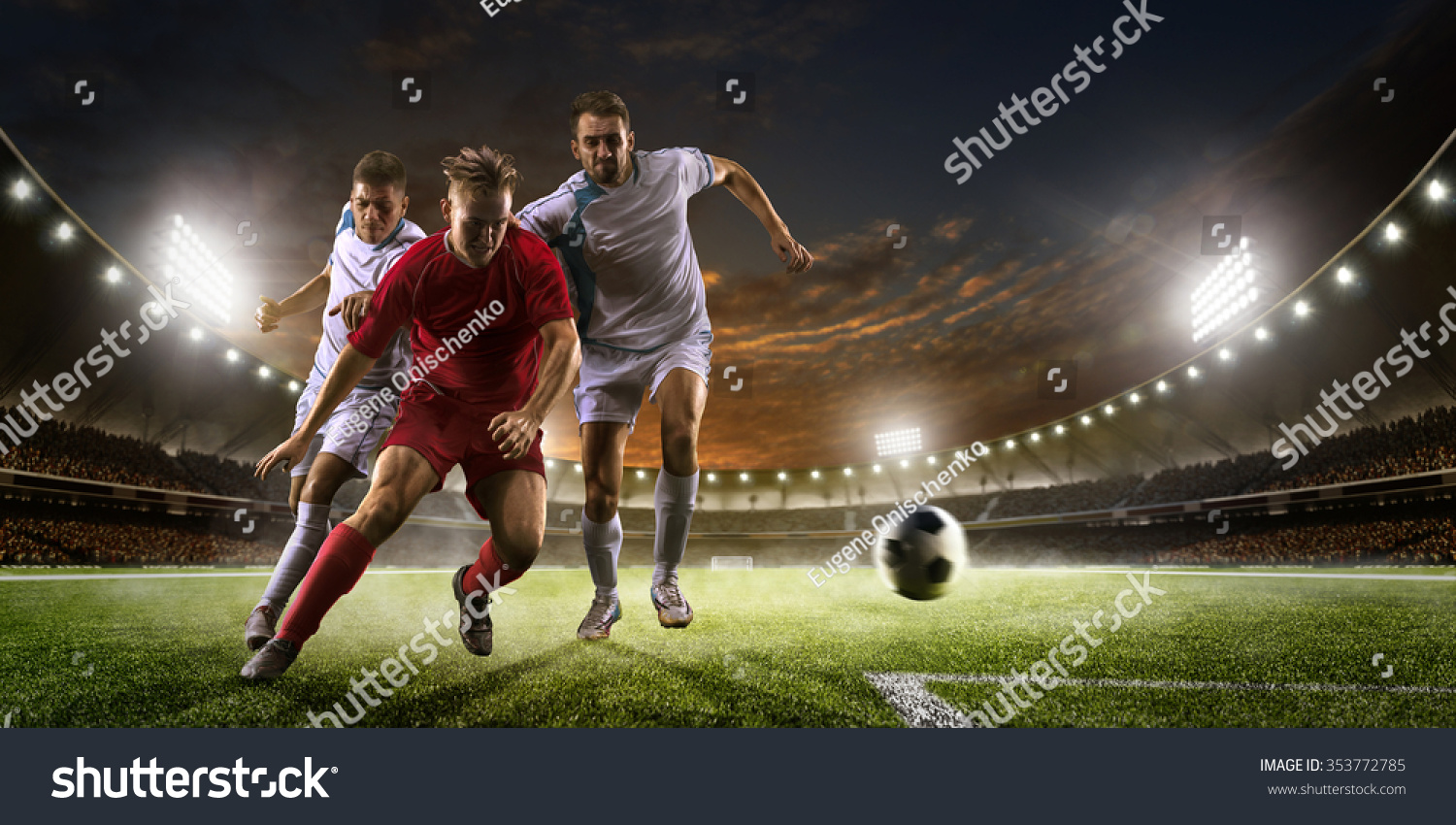 Soccer Backgrounds Stock Photo: Soccer Players Action On Sunset Stadium Stock Photo