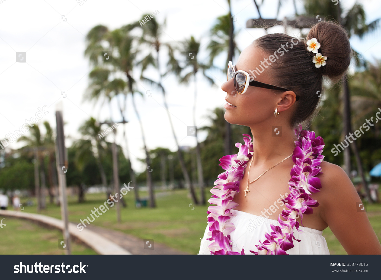 Hawaii woman flower lei garland pink stock photo safe to use hawaii woman with flower lei garland of pink orchids beautiful smiling woman in white dress izmirmasajfo