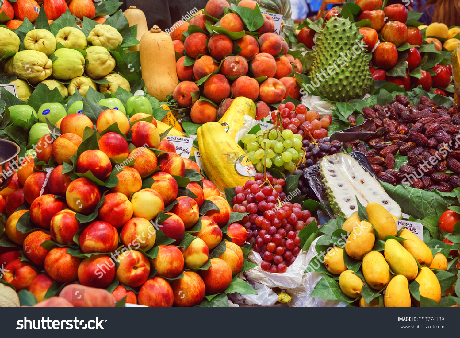 BARCELONA, SPAIN - September 29: Fresh Vegetables and Fruits in market on September 29, 2015 in Barcelona, Spain. Famous La Boqueria market / photography of the variety of fruits at the market. #353774189