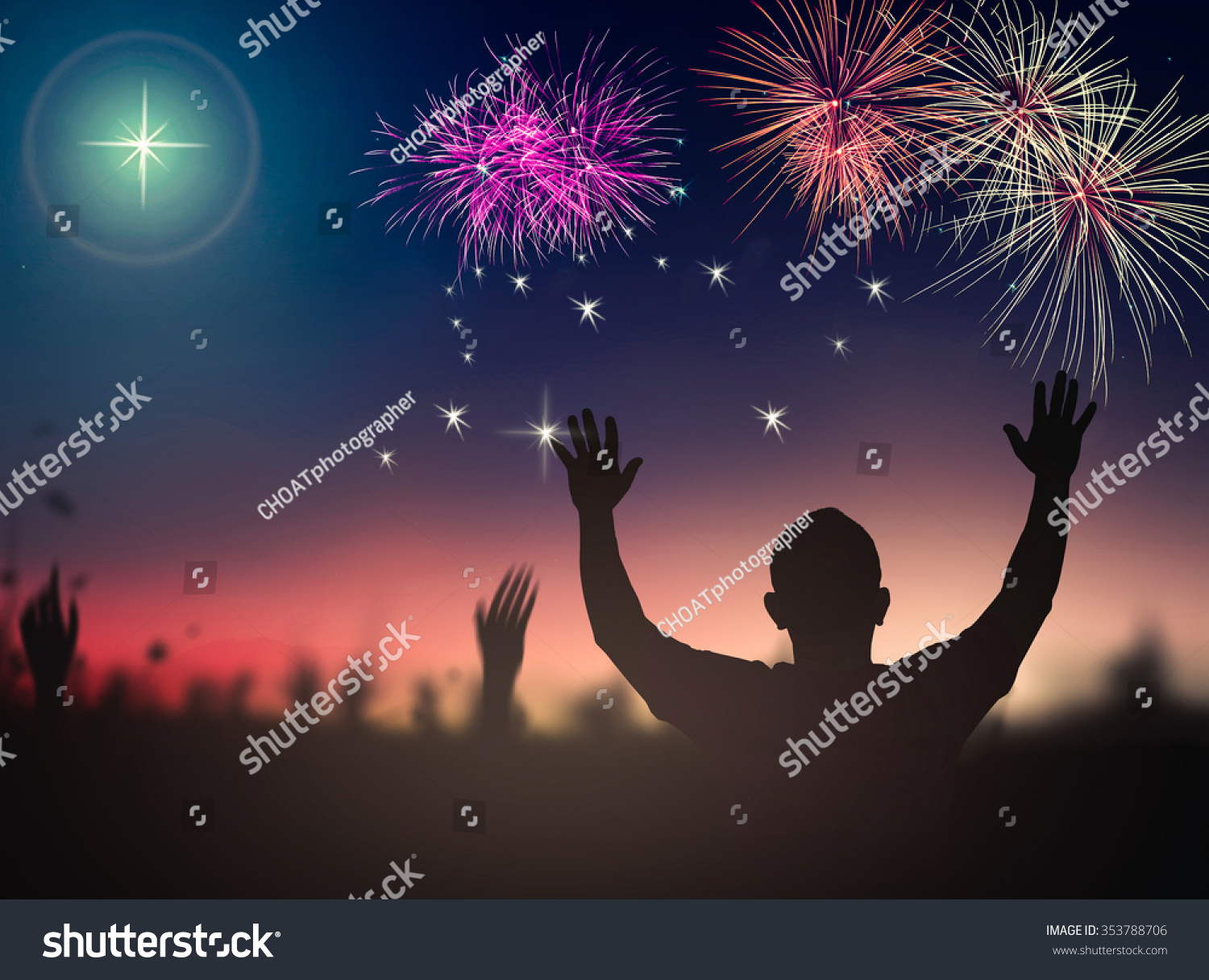 happy new year 2019 concept silhouette people raising hands for worship god over beautiful fireworks