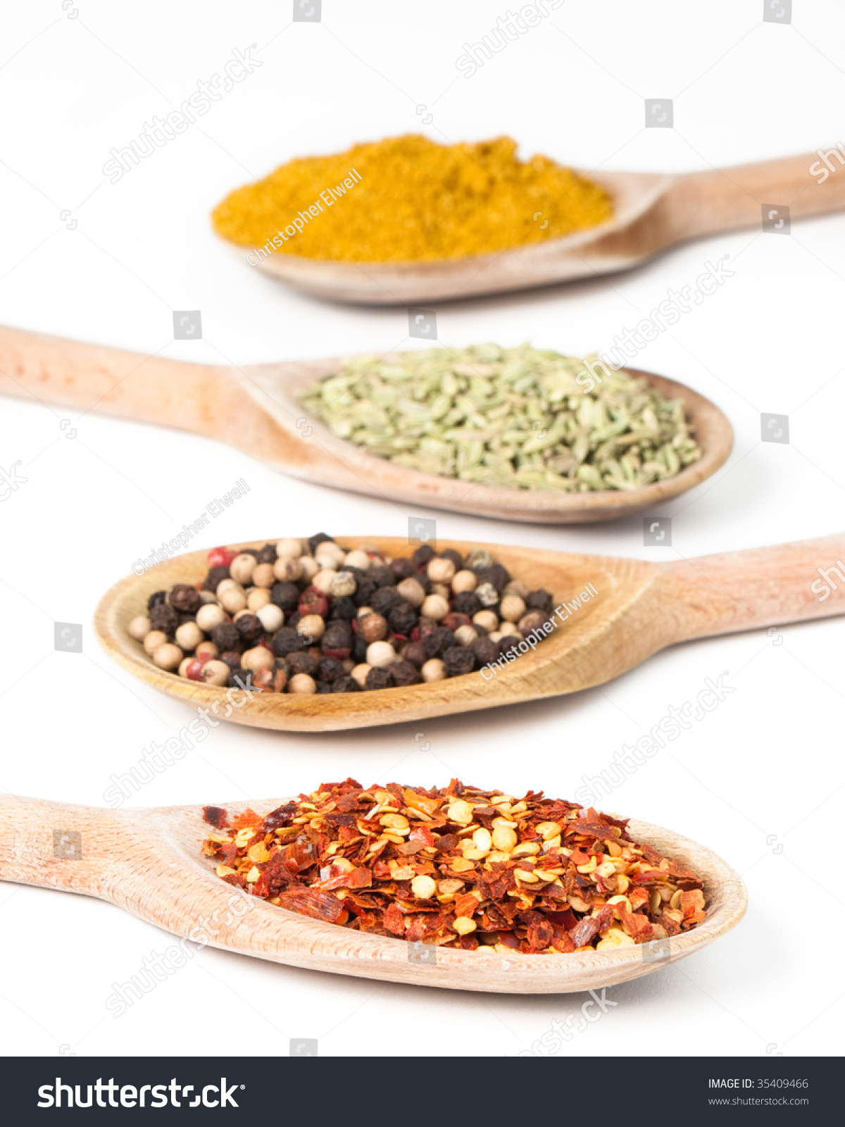 Colorful Spoons: Row Of Colorful Spices On Rustic Wooden Spoons Stock Photo