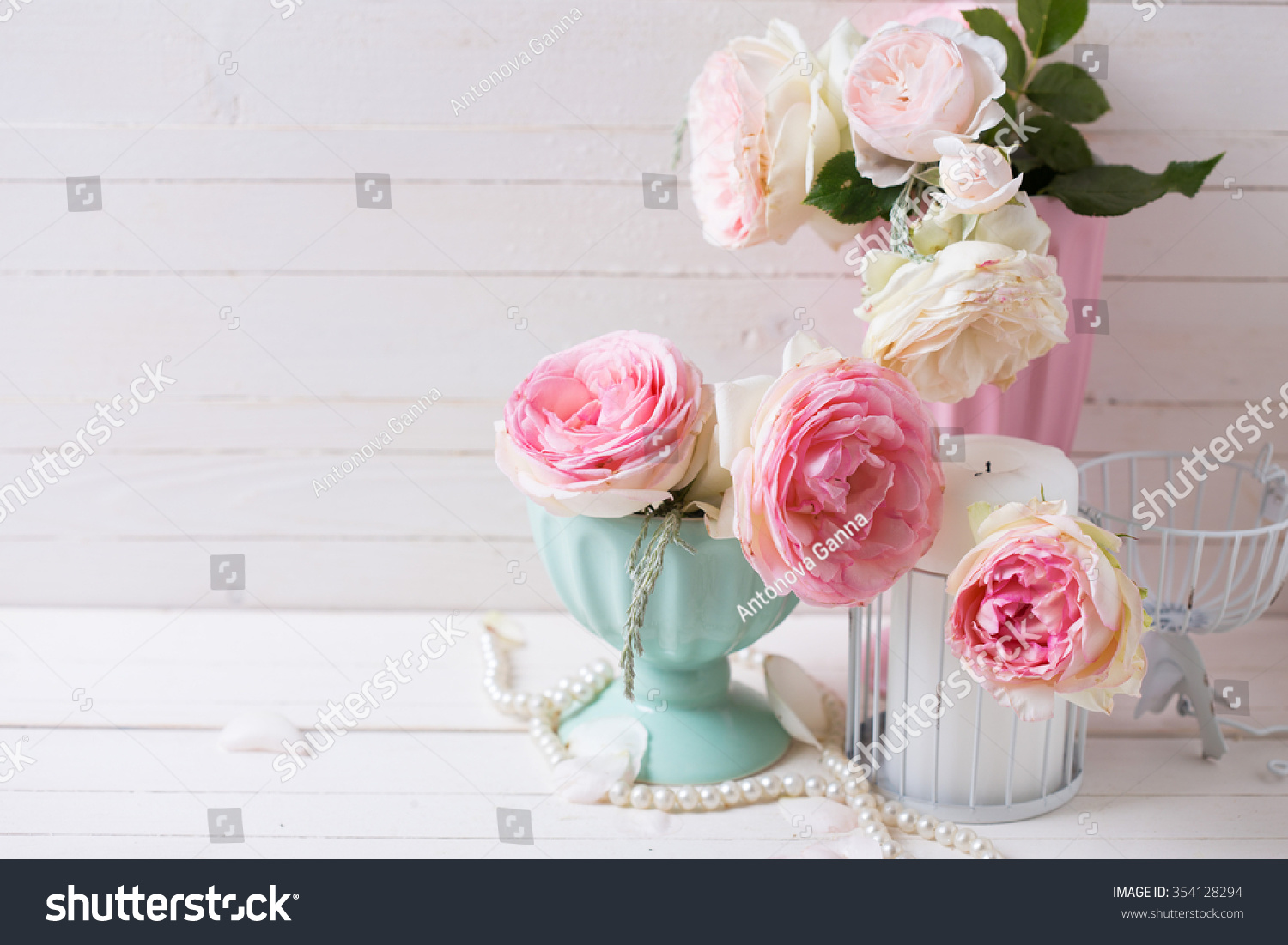 Sweet pink roses flowers vases candle stock photo 354128294 sweet pink roses flowers in vases and candle on white painted wooden background selective focus reviewsmspy