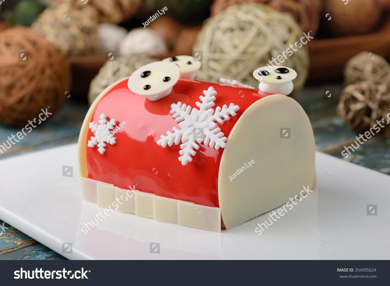 Red shinning color christmas log cake stock photo