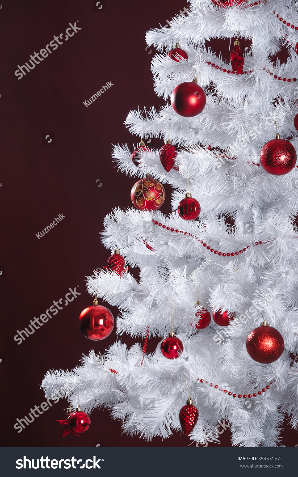 White christmas tree with red balls stock photo