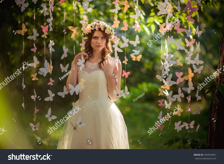 Beautiful bride in white dress in the garden | EZ Canvas
