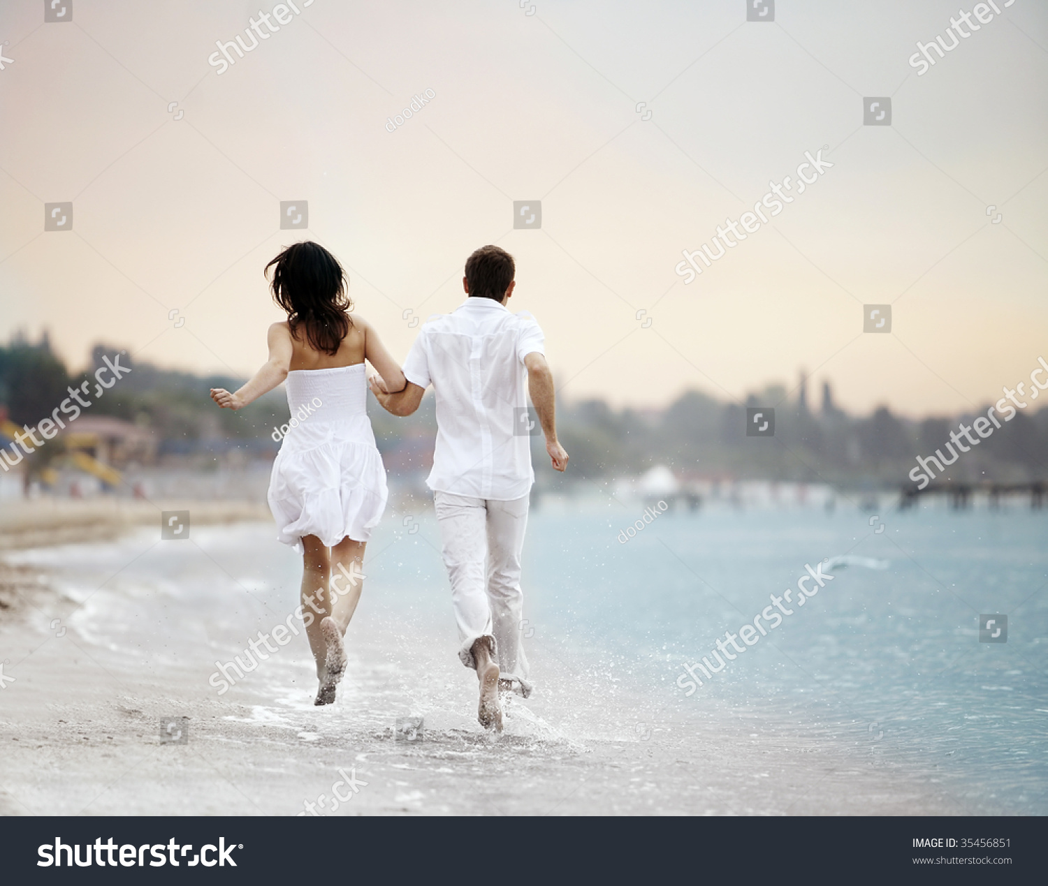 Couple Holding Hands Running Away Over Stock Photo