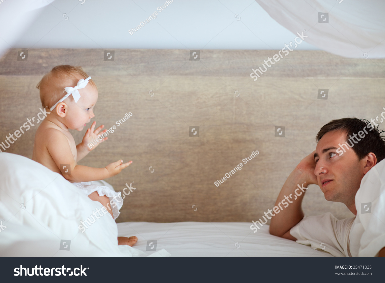 Baby girl talking to dad
