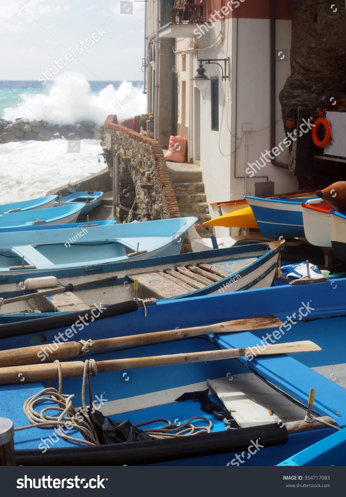 Small fishing row boats on land during rough sea rio for Fishing row boats