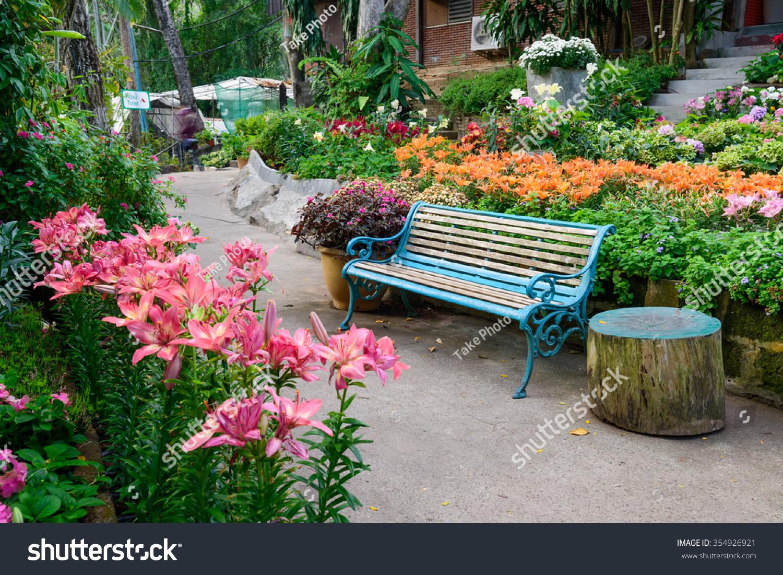 Empty park bench in a beautiful flower garden ez canvas id 354926921 izmirmasajfo