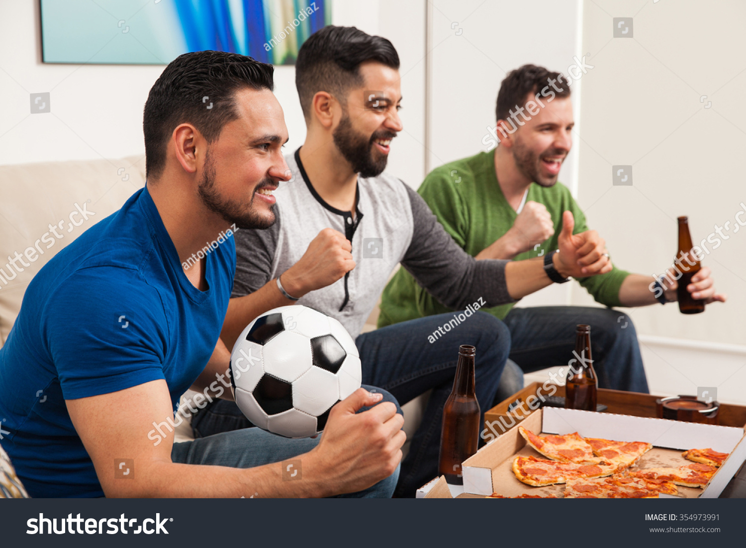 three young latin men celebrating goal stock photo 354973991 three young latin men celebrating a goal while watching a soccer game at home pizza