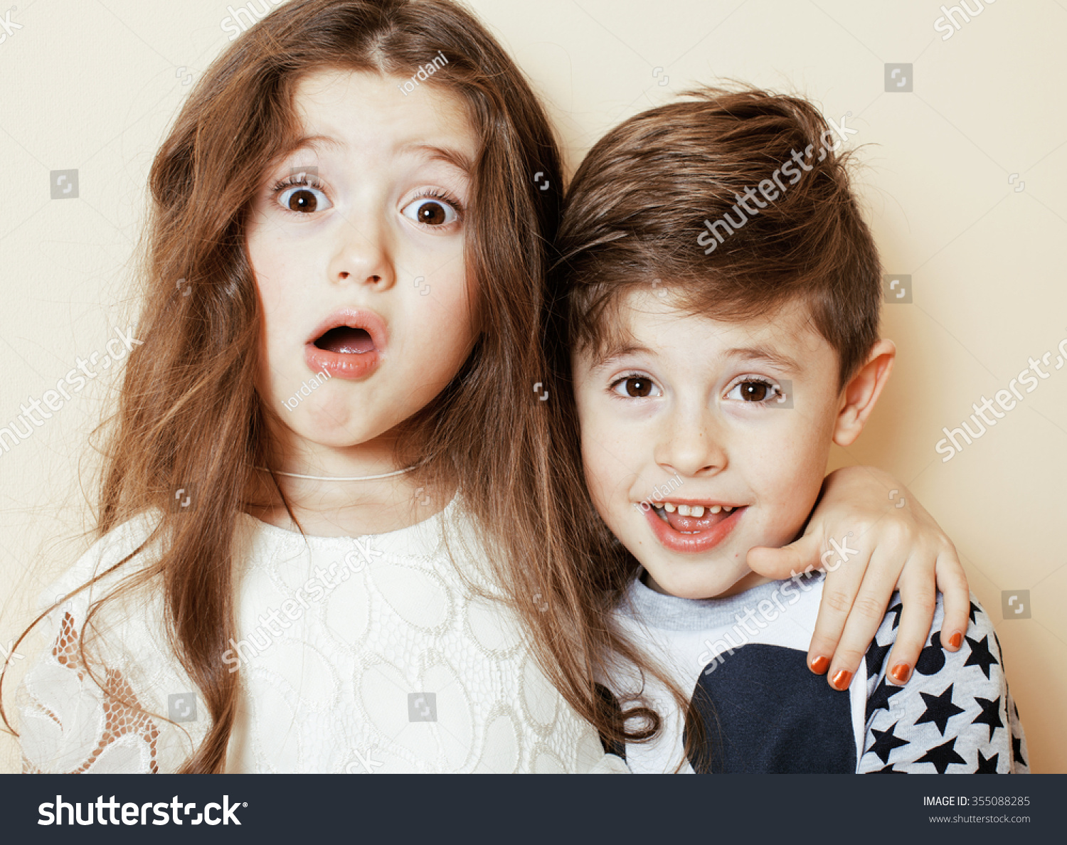 little cute boy girl hugging playing stock photo (royalty free